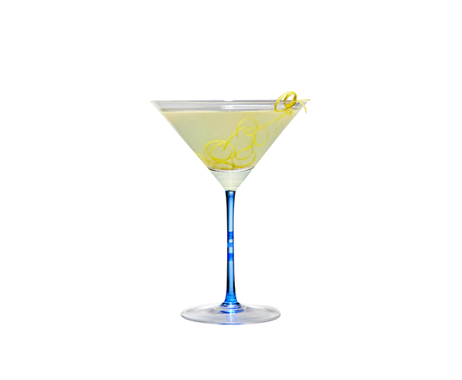 Cocktail glass with a yellow drink made with a lemon drop recipe.