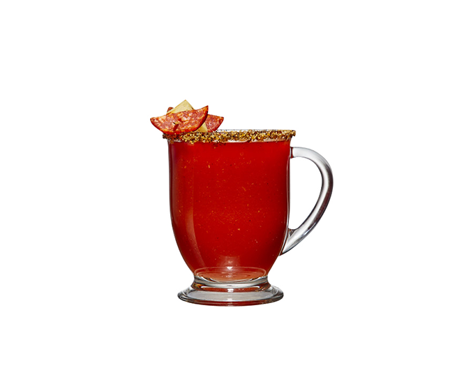 Glass mug filled with one of Agalima's red hot cocktails.